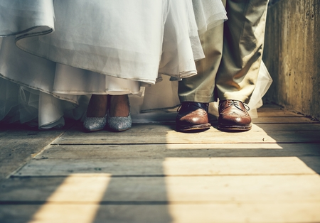 Shoes of the bride and groom Stock Photo