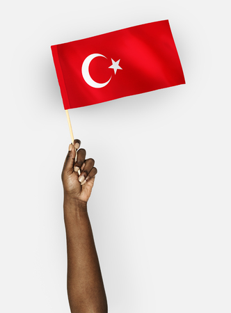 Person waving the flag of Republic of Turkey