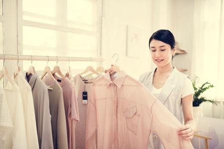 Customer checking out clothes 写真素材