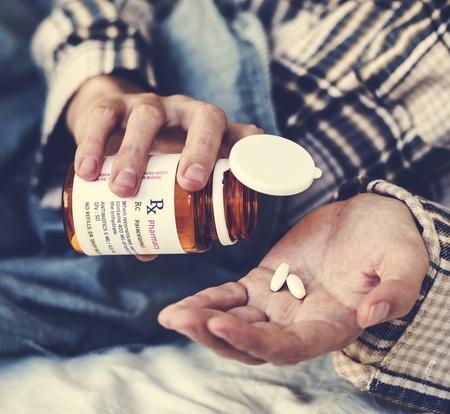 Closeup of pills on palm