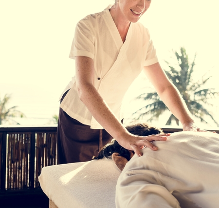 Female massage therapist giving a massage at a spa Stock fotó