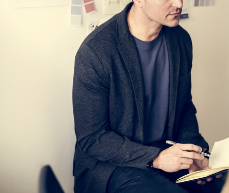 Caucasian man taking a note Stock Photo