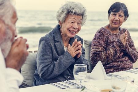 Seniors having a dinner party at the beach