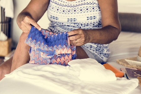 Woman packing for a holiday Stockfoto