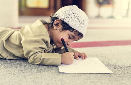 Muslim boy learning in a mosque Stock Photo - 110548099
