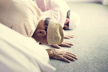 Muslim people praying in Sujud posture Stock Photo