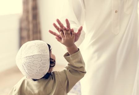 Muslim boy giving a high five