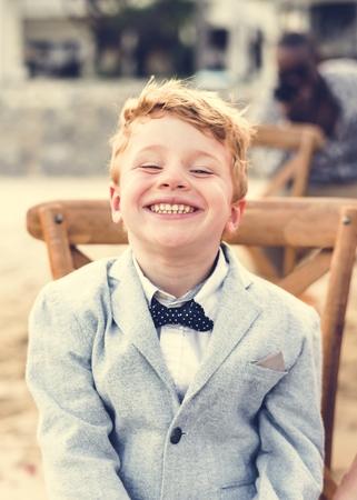 Happy boy at a beach wedding Archivio Fotografico - 110548902