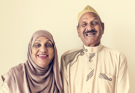 Senior Muslim couple at home Stock Photo