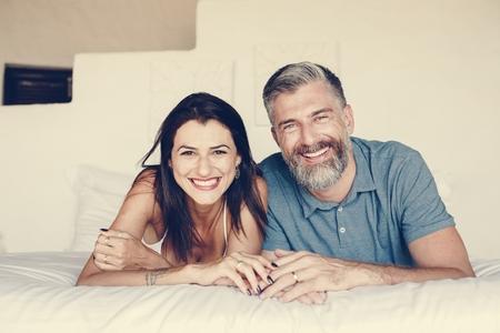 Couple spending their honeymoon in bed Imagens