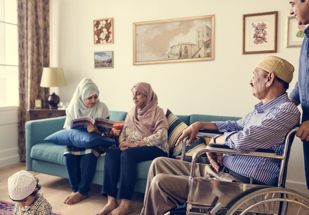 Muslim family relaxing in the home Stock Photo - 110549410