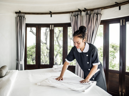 Housekeeper cleaning a hotel room Stock Photo