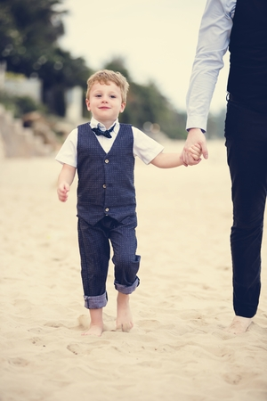 Father and son at a beach wedding Stok Fotoğraf