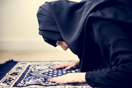 Muslim woman praying in Sujud posture