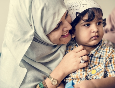 Muslim mother and her son Stock Photo - 110521880