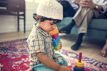 Muslim family relaxing and playing at home Stock Photo - 110522268