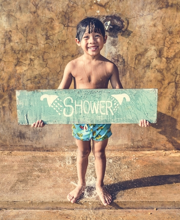 Boy holding a shower board sign