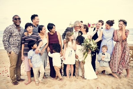 Happy friends and family at a wedding party Stock Photo - 110522837