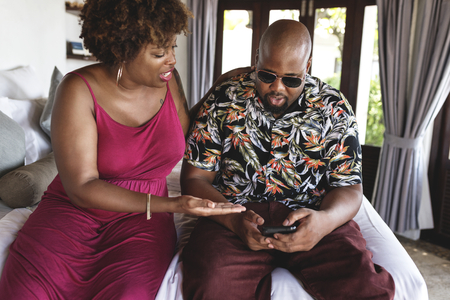 African American man using phone on vacation
