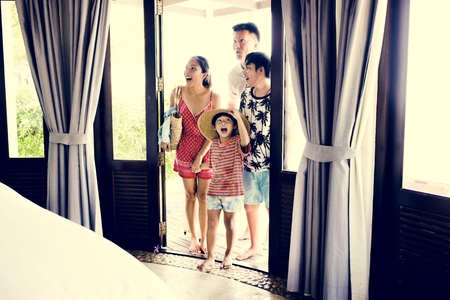 Asian family on vacation Imagens