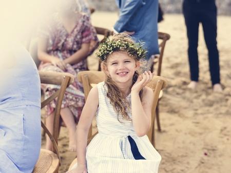 Little bridesmaid at a beach wedding
