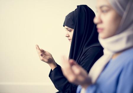 Muslim women making Dua to Allah Stock Photo