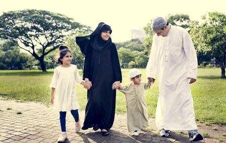 Muslim family having a good time outdoors