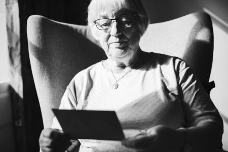 Senior woman looking at a photo