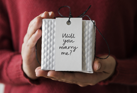 Woman holding a marriage proposal gift