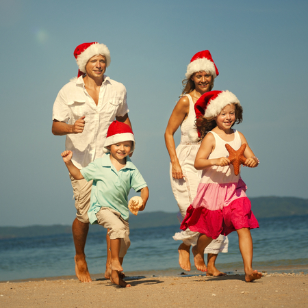 Family enjoying a Christmas holiday at the beach