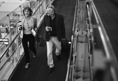 Caucasian couple talking together at the airport Stock Photo