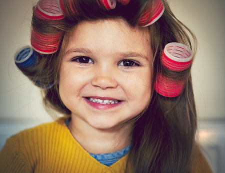 Cute little girl having a hairstyle makeover 스톡 콘텐츠