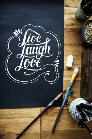Hand lettering on black paper Stock Photo
