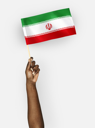 Person waving the flag of Islamic Republic of Iran 스톡 콘텐츠