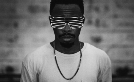 African man wearing led shades