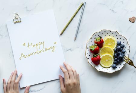 Feminine flat lay of a phrase Happy Anniversary