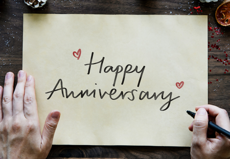 Phrase Happy Anniversary on a paper
