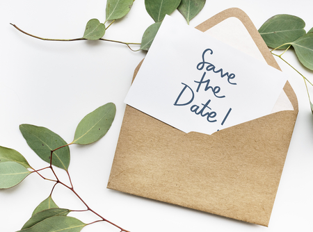 Phrase Save the Date in plants background