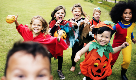 Little kids at a Halloween party Imagens