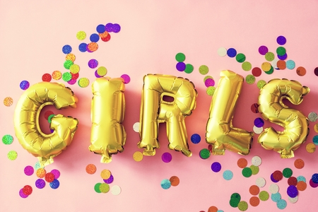 Closeup of girls balloon word on pink background Stock Photo