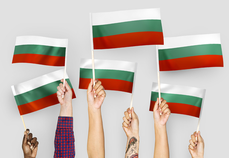 Hands waving flags of Bulgaria