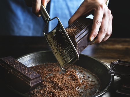 Woman grating a chocolate bar food photography recipe idea