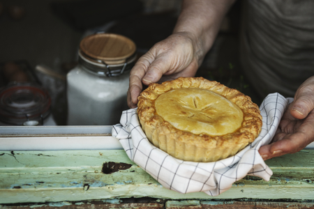 Grandmother holding a freshly baked pumpkin pie