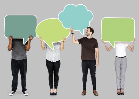 People holding colorful speech bubbles 免版税图像 - 110597474