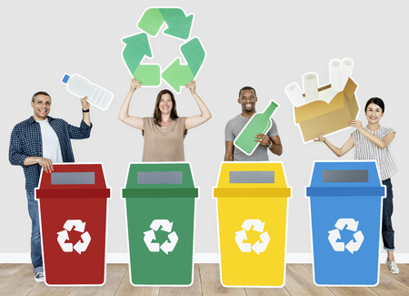 Group of people holding recycle icons