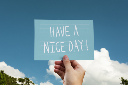 Have a nice day phrase written on a card