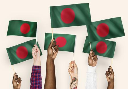 Hands waving flags of Bangladesh