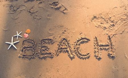 Beach written in the sand Stock Photo