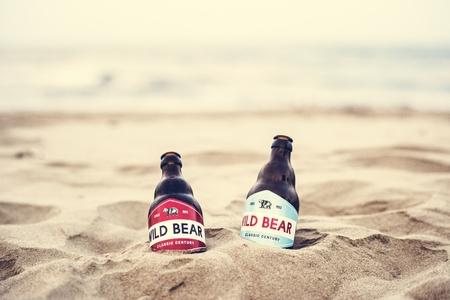 Two beer bottles buried in the sand Zdjęcie Seryjne