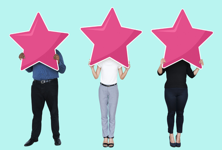 Diverse businesspeople showing star rating symbols Stock Photo